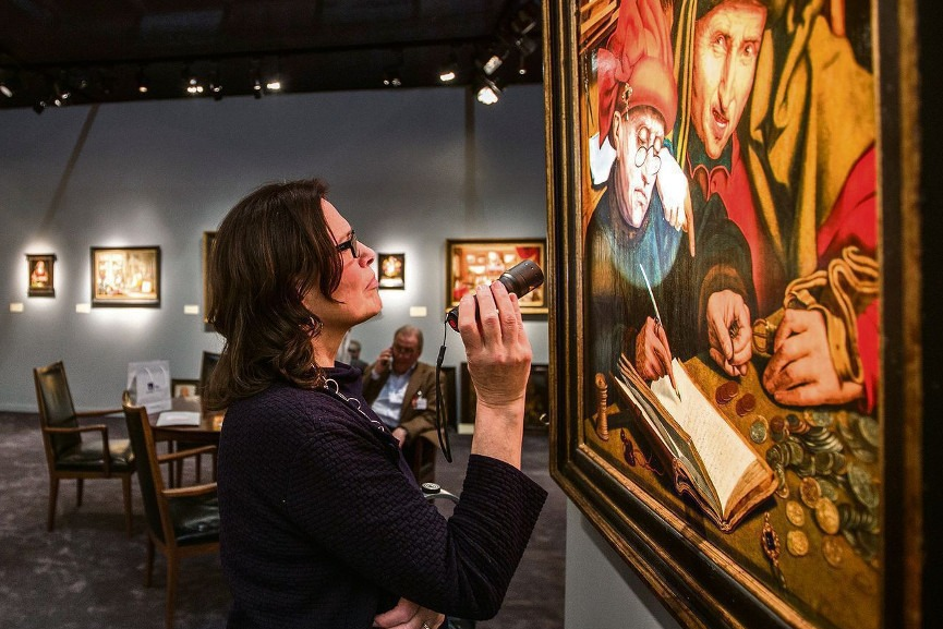 An Art Dealer Lookin at at Artwork - Image via nrccom