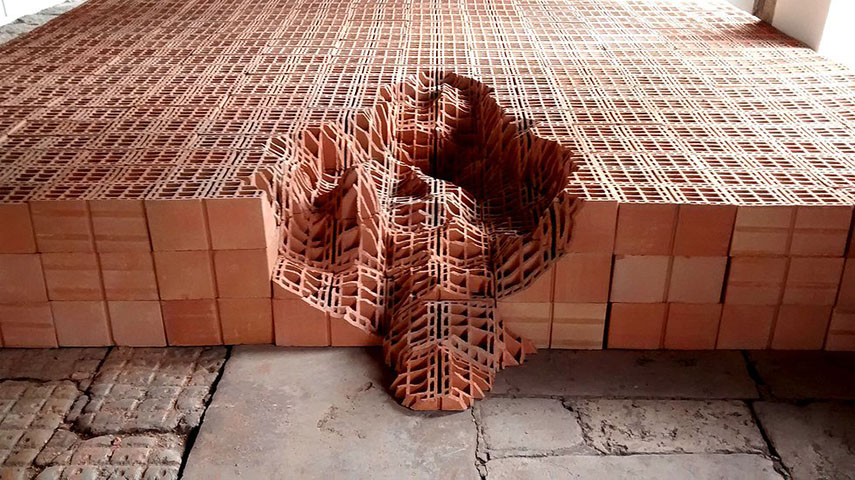 Andrey Zignnatto - Erosões #1, 2013-14. Brick blocks and tiles, 60 x 600 x 800 cm. Courtesy the artist, for illustrative purposes only rero work installation french rero