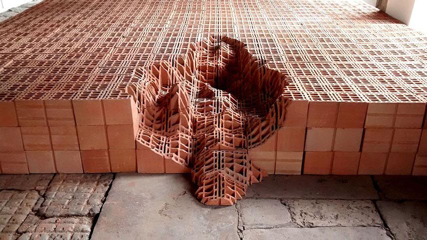 Andrey Zignnatto - Erosões #1, 2013-14. Brick blocks and tiles, 60 x 600 x 800 cm. Courtesy the artist, for illustrative purposes only rero work installation french rero