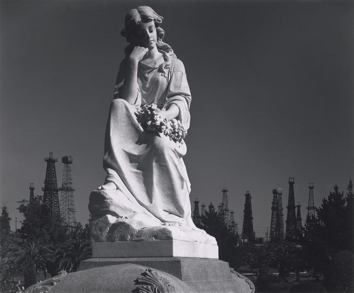 Ansel Adams - Cemetery Statue and Oil Derricks