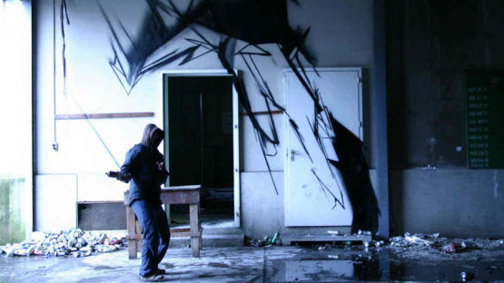 Antistatik in front of his work - image via graffuturism.files.wordpress.com