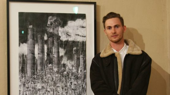 Arthur Laidlaw in front of his artwork