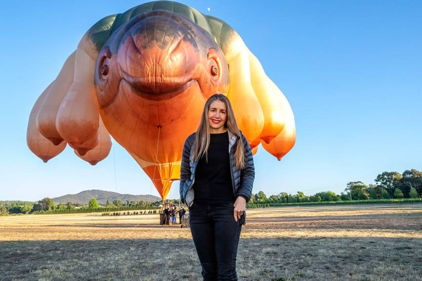 Artist Patricia Piccinini standing in front of Skywhale