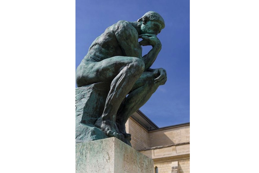 Auguste Rodin created The Thinker at the age of 40; on view in Paris, France, a fine example of Rodin's arts on view at Rodin Museum
