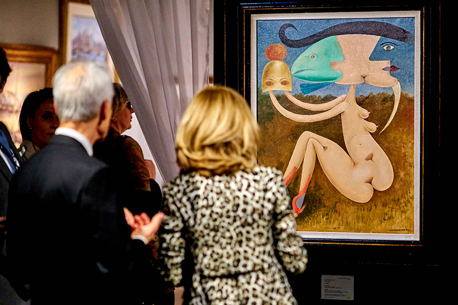BRAFA 2018 visitors observe Victor Brauner painting at Stern Pissarro booth