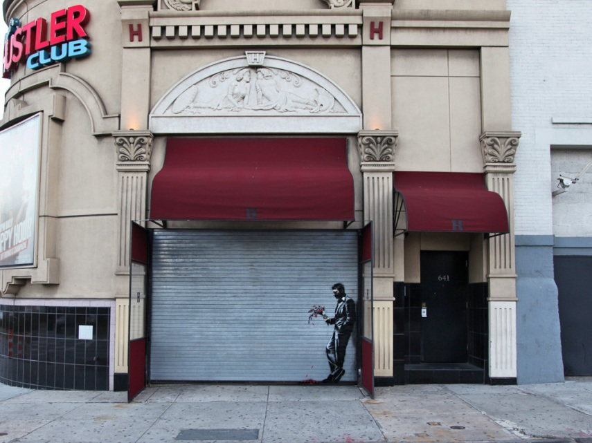 Banksy's work 'Waiting in vain…at the door of the club' on Larry Flynt's Hustler Club in Hell's Kitchen, New York, 2013