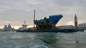 The migrant shipwreck of 18 April 2015 being transported from the Pontile Marina Militare di Melilli (NATO) to the Arsenale in Venice, Italy.