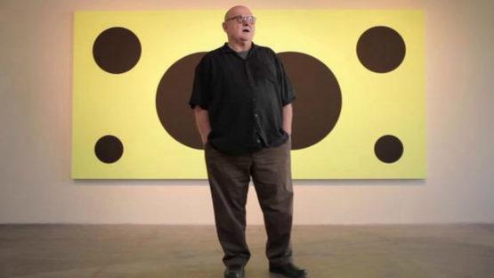 Bob Zoell in fron of his his artwork, Image via Vimeo