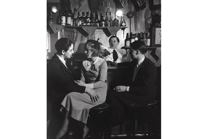Brassaï - Le Monocle, the bar. On the left is Lulu de Montparnasse, c. 1932