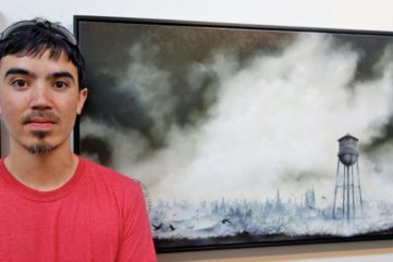 Brian Mashburn in front of his artwork