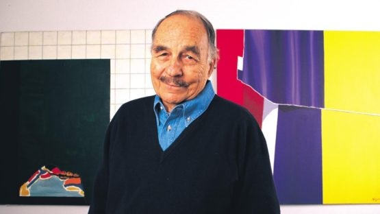 Burhan Dogancay in front of his work