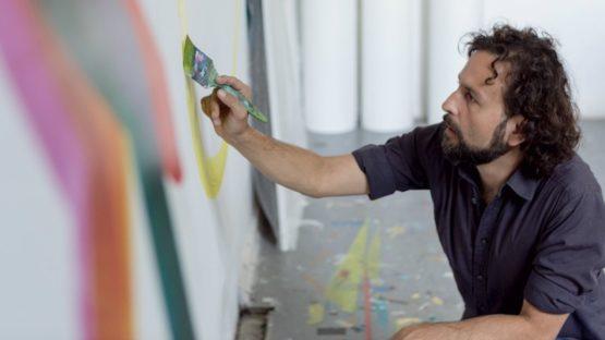 Carlos Silva painting in the studio