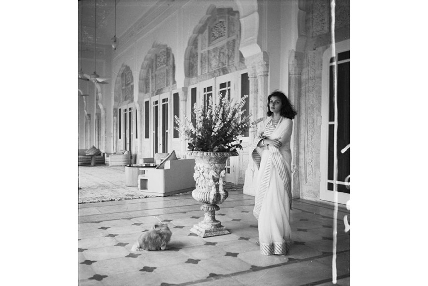 Cecil Beaton - Political Personalities: Full length portrait of the Maharanee of Jaipur wearing a sari