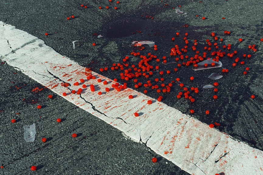 Cherries spilled on crosswalk, New York City, USA, 2014© Christopher Anderson Magnum Photos