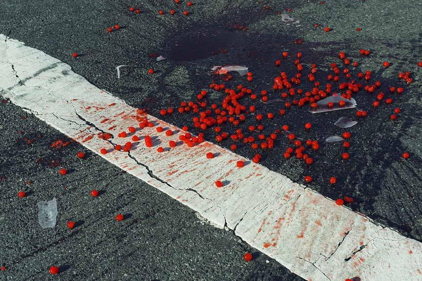 Cherries spilled on crosswalk, New York City, USA, 2014© Christopher Anderson Magnum Photos