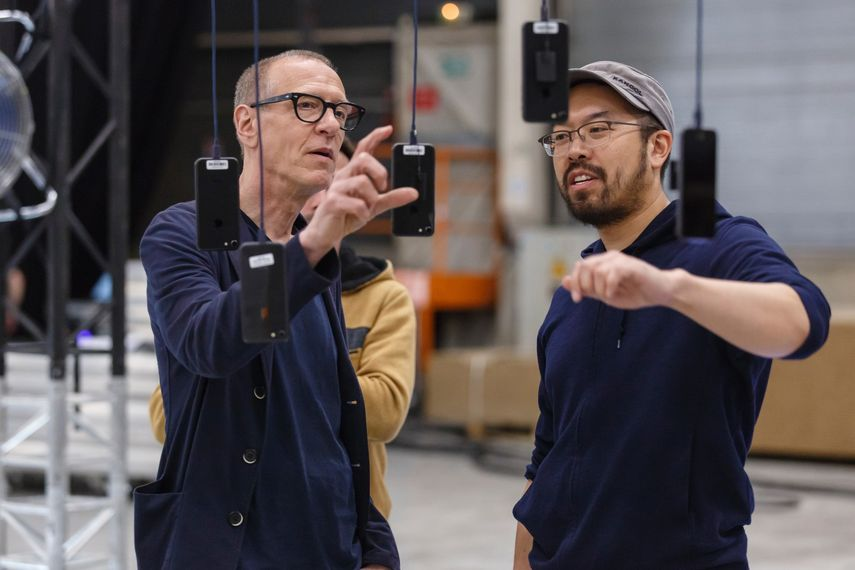 Christian Marclay and Snap engineer Andrew Lin examining elements of Talk to Me:Sing to Me (detail), 2018