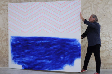 Claude Tetot with one of his artworks