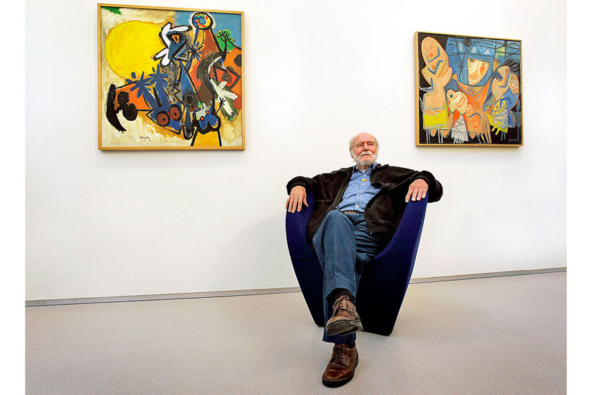 Corneille in front of some of his works in June 2007 at the CoBrA Museum