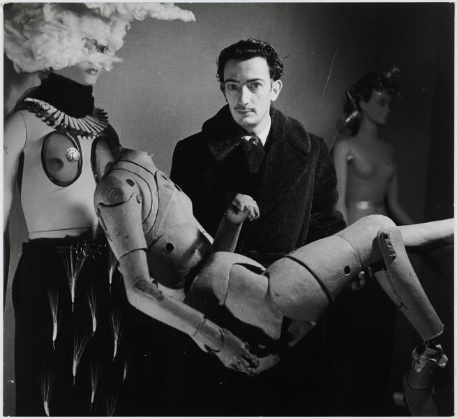 Denise Bellon - Salvador Dalí and his mannequin at the Exposition Internationale du Surréalisme, Paris, 1938