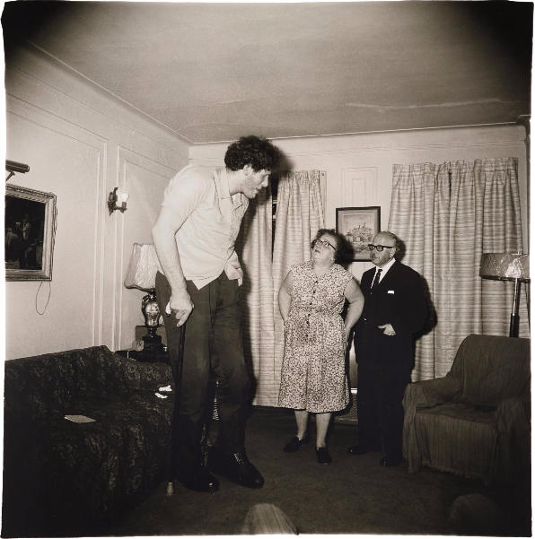 Diane Arbus-A Jewish giant at home with his parents in the Bronx, N.Y.-1970