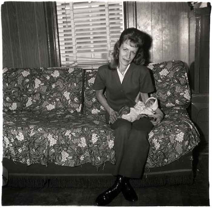 Diane Arbus-A woman with her baby monkey, N.J.-1971