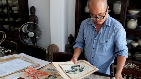 Dinh Q. Le in his studio