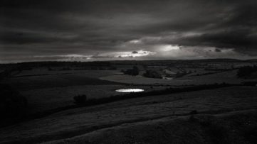 Don McCullin - Dew Pond by Iron Age Hill Fort, Somerset, 1988