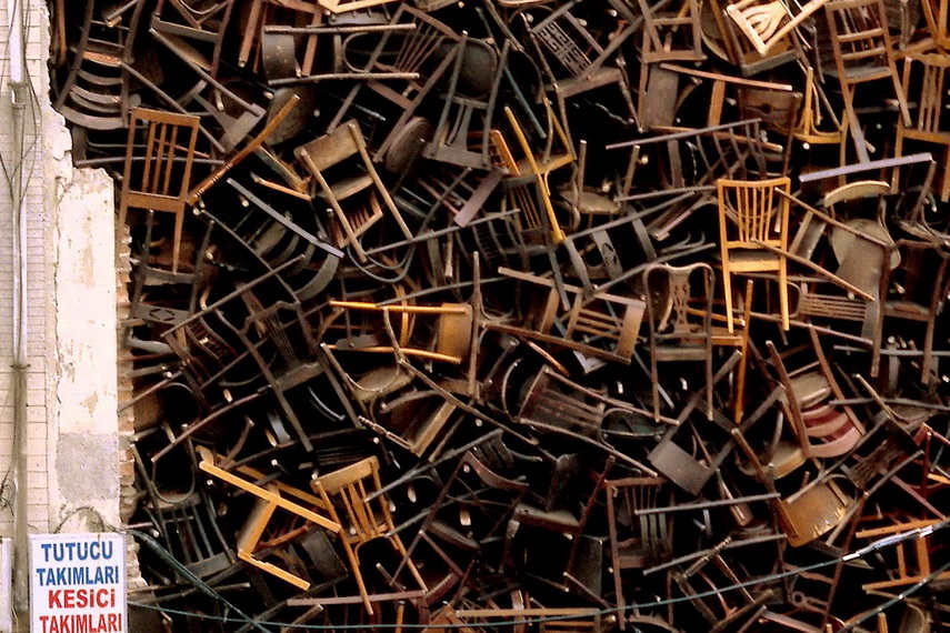 Doris Salcedo - 1550 Chairs Stacked Between Two City Buildings, 2003, Installation at Istanbul Biennial - image courtesy of alchetron.com