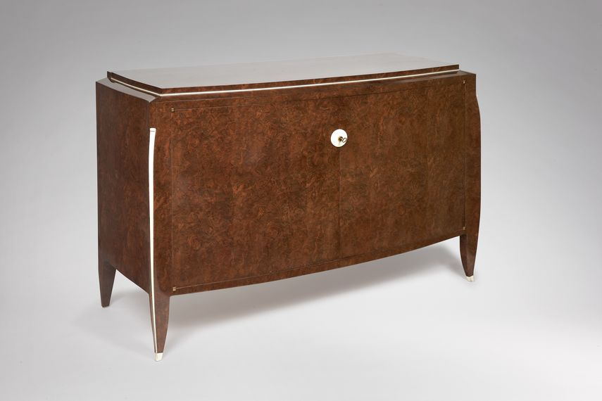 French designer designed modern Art deco table and cabinet out of material like ebony and  macassar