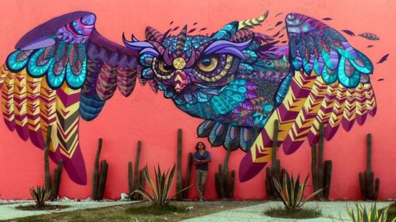 Farid Rueda - Artist in front of his work - Photo Credits Farid Rueda