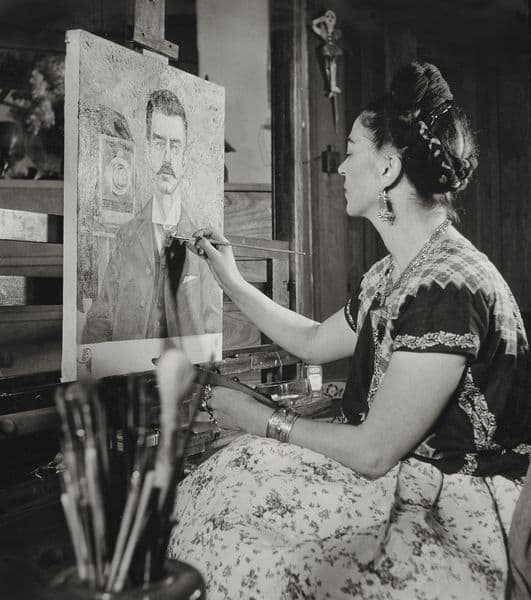 Frida painting the portrait of her father, by Gisèle Freund, 1951