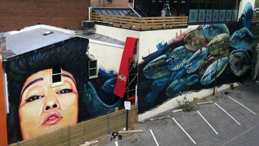 gaia's  street art mural next to a gallery in Washington DC,