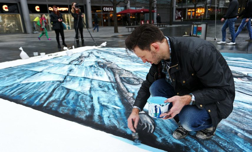 An image of the artist working on the HBO commission of a 3D street art of The Wall in London - Original gift was a commission of a featured portrait