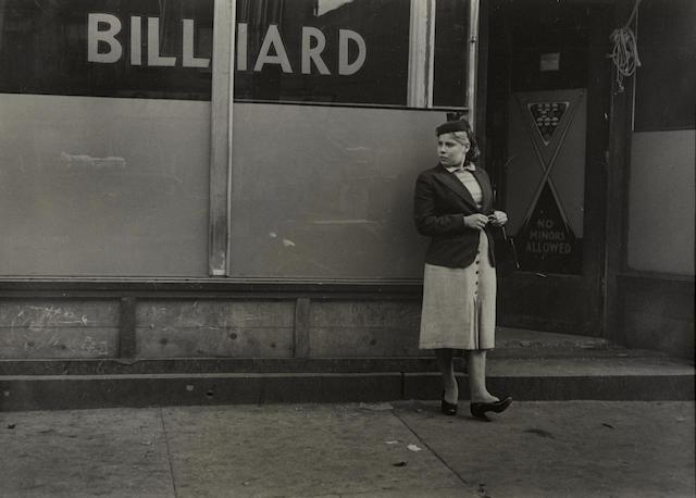 Helen Levitt-New York (Woman and Billiard Sign)-1942