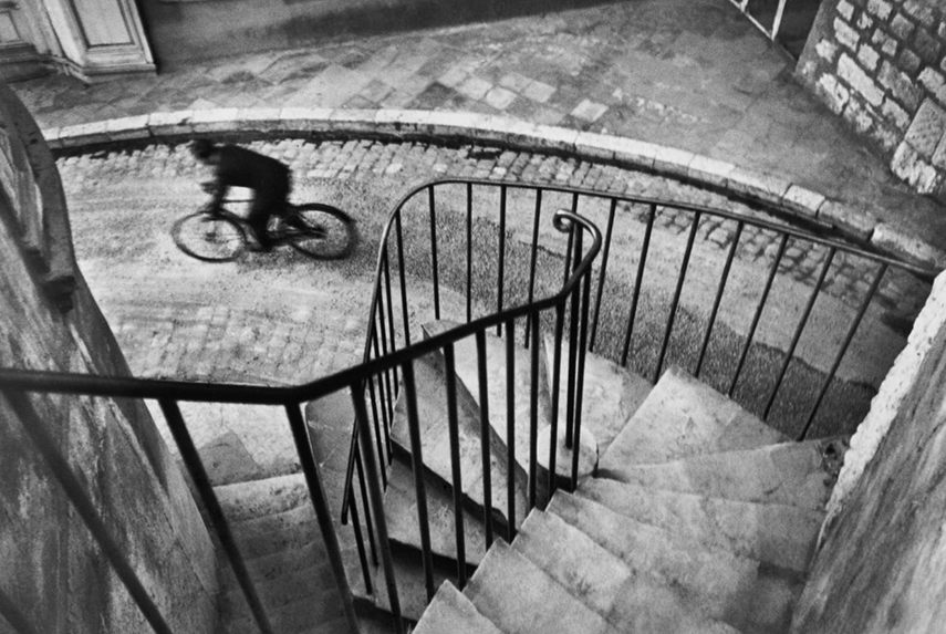 use Henri Cartier-Bresson - Man Cycling Down Street, Hyeres, France, 1932