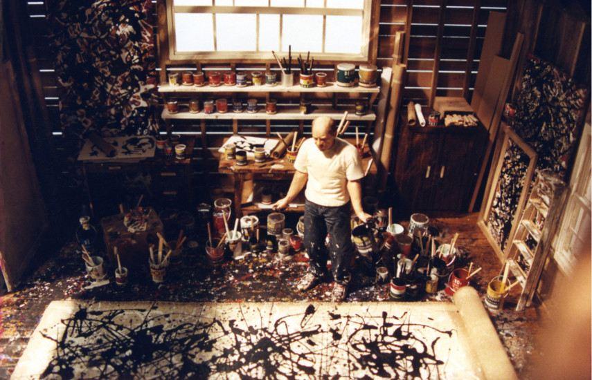 Photo portrait of the legendary Jackson Pollock working in his studio