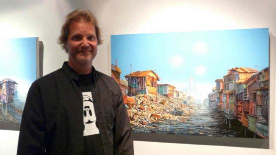 Jeff Gillette in front of his artwork, image via Arrested Motion