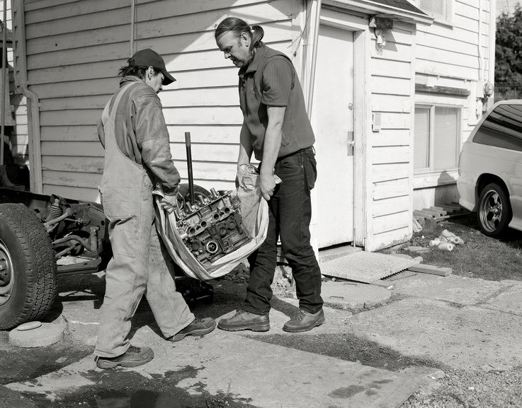 Jeff Wall - Men move an engine block