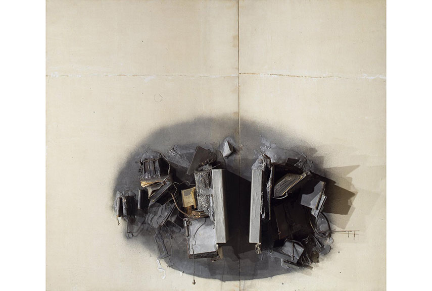 John Latham - Great Noit, 1962. Logs covered with canvas, books, wires, leather wallet, machine fragments, springs, plaster on canvas on hardboard, 327 x 383.5 x 40.5 cm. Copyright the Estate of the Artist. Courtesy Richard Saltoun Gallery