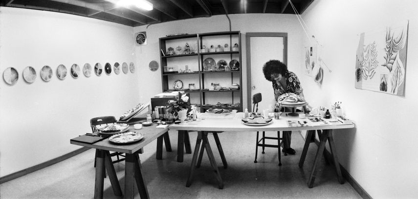 Judy Chicago in the China Painting Studio while working at the Dinner Party, 1975