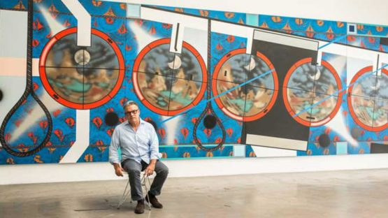 Lari Pittman in front of his painting Flying Carpet With Waning Moon Over a Violent Nation, contemporary art