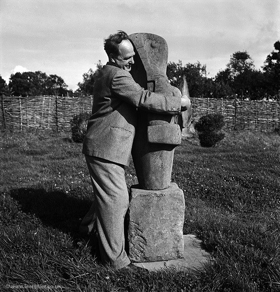 Lee Miller - Henry Moore with his sculpture Mother and Child