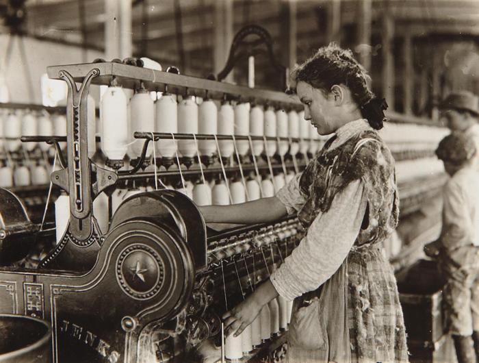 Lewis Wickes Hine-Spinner in Vivian Cotton Mills, Cherryville, N.C. Been at it 2 years. Where will her good looks be in ten years? Location: Cherryville, North Carolina, November-1908