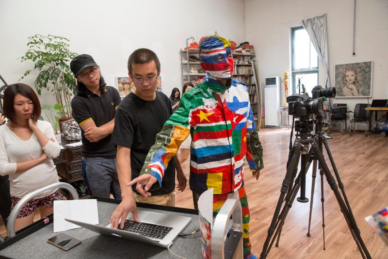 Liu Bolin in his studio, making of The Future, 2015