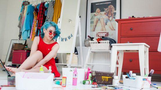 Lora Zombie in her studio, grunge art