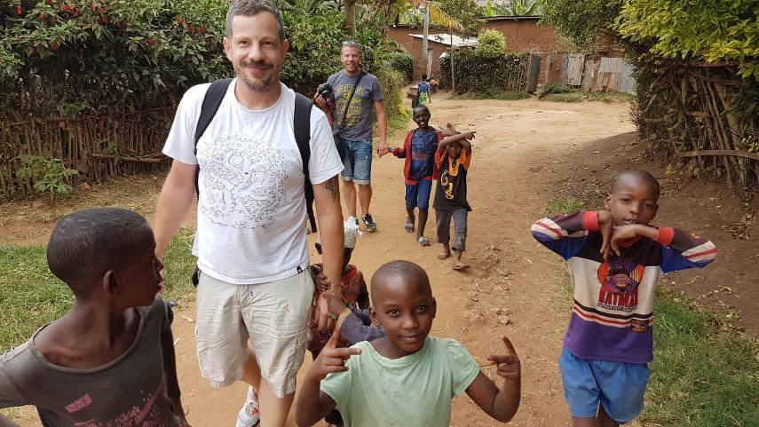 Lunar - Photo of the artist with the local kids, Kigali, Rwanda, 2017 - Image courtesy of Lunar