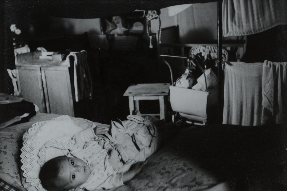 Child Lying on a Jewish Benda Bed, 1945