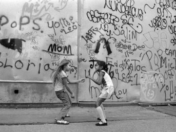 Martha Cooper - Girls Dancing to Disco Music from a Bar Against Graffiti Wall