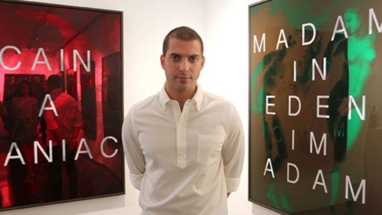 Massimo Agostinelli, in front of his works at Hus Gallery, 2015, photo credits - artist