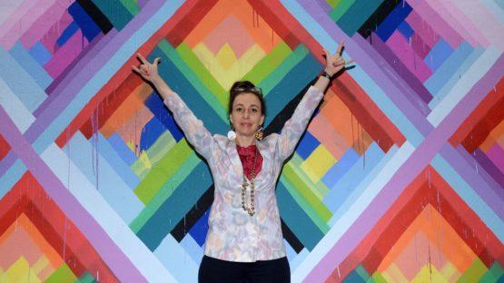 Maya Hayuk - In front of her mural
